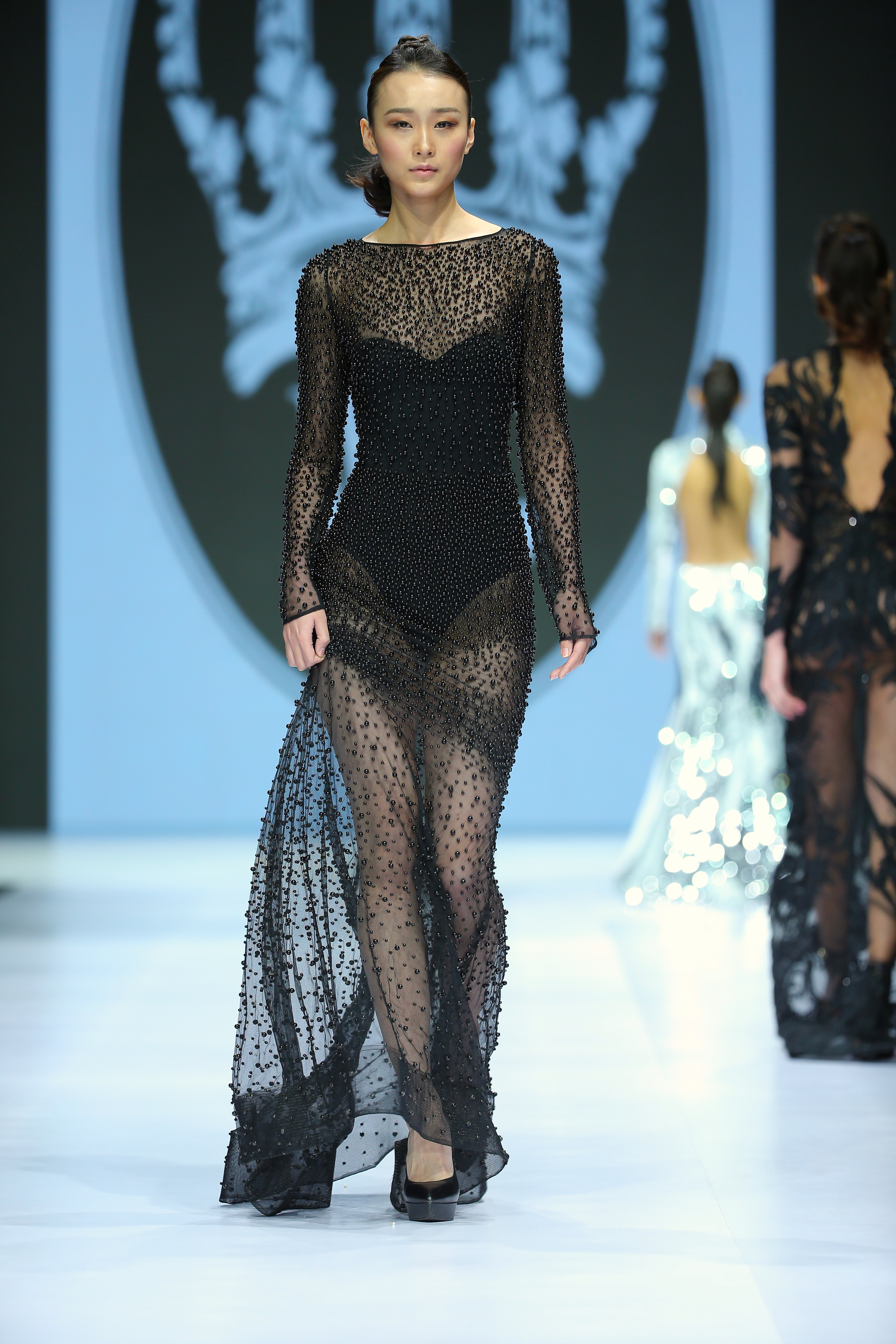 A model wears a design by Willfredo Gerardo at the Mercedes-Benz Fashio Week - CHINA